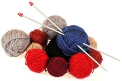 Balls of wool and knitting needles royalty free stock images