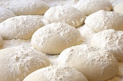 Balls of dough. Covered with wheat flour ready for baking Stock Image