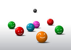 Balls emoticons. Eight colored balls with a smile and frown Stock Images