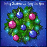 Balls fir Christmas wreath. On a blue snow-covered background Royalty Free Stock Photos