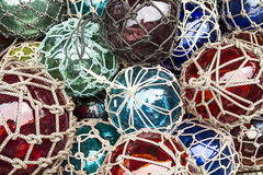 Balls of glass with rope Stock Photo