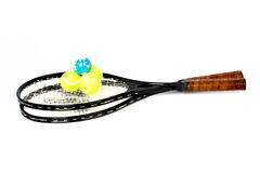 Balls and globe on tennis racket Stock Photo