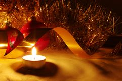 Balls and gold ribbons it are Christmas. The burning candles, balls and gold ribbons it are Christmas royalty free stock images