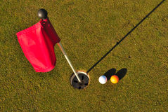 Balls golf next to to hole stock photography