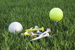 Balls of golf white and yellow. Stock Photos