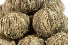Balls of green tea. Closeup of balls of exclusive green Chinese tea Royalty Free Stock Photo