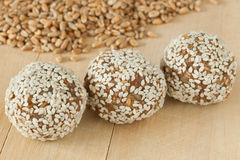 Balls from ground wheat sprouts with sesame seeds Stock Photo