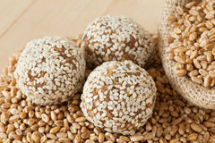 Balls from ground wheat sprouts with sesame seeds Royalty Free Stock Images