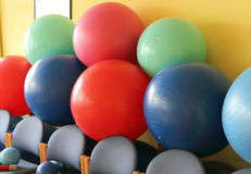 Balls in a gymnasium room Royalty Free Stock Photography