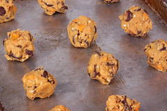 Balls of home-made cookie dough ready to be baked Stock Photo