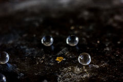 Balls of hydrogel on black metal background. Stock Image