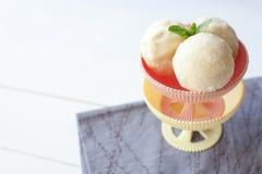 Balls of ice cream in bowl Stock Photo