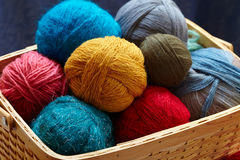 Balls of knitted wool in basket Royalty Free Stock Images