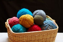 Balls of knitted wool in basket Royalty Free Stock Photos