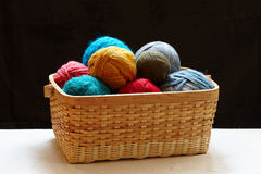 Balls of knitted wool in basket Stock Photo