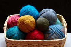 Balls of knitted wool in basket Stock Images