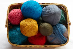 Balls of knitted wool in basket Stock Photos