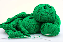 Balls and Knitting Needles fisherman`s rib  pattern Stock Images