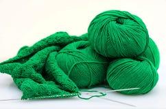 Balls and Knitting Needles fisherman`s rib  pattern Royalty Free Stock Images