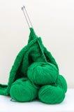 Balls and Knitting Needles fisherman`s rib pattern Royalty Free Stock Image