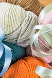 Balls of knitting yarns in the basket Royalty Free Stock Photos