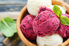 Balls lemon and berry ice cream in a bowl close up. Royalty Free Stock Images