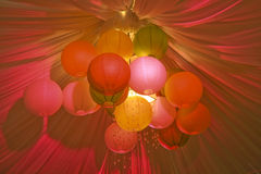 Balls of light. A colorful decoration consisting of paper balls lighted in different colors Stock Images