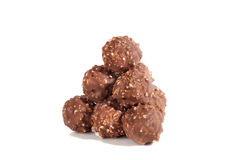 Balls of milk chocolate lie in form of pyramid Royalty Free Stock Image