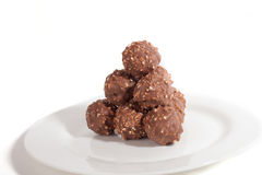 Balls of milk chocolate lie in form of pyramid Stock Photography