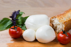 Balls mozzarella different size with tomatoes cherry, bread and Royalty Free Stock Images