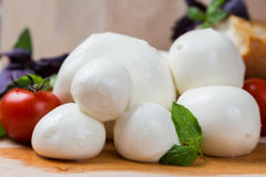 Balls mozzarella different size with tomatoes cherry, bread and Stock Photography