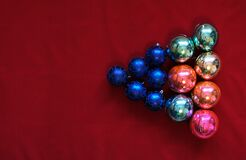 Balls, multicolored Christmas toys on the background