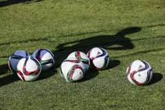 Balls of Paok team on the field of the stadium during team pract Royalty Free Stock Photos