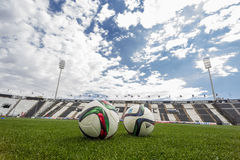 Balls of Paok team on the field of the stadium during team pract Stock Image