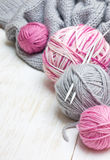 Balls of pink and gray yarn Royalty Free Stock Photos