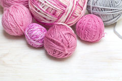 Balls of pink and gray yarn Stock Photo