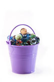Balls. Plastic baby purple bucket with multicolored glass balls on a white background Stock Photography