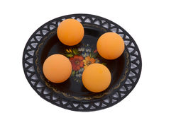 Balls on the plate. Ping-pong balls on the plate, sport equipment Royalty Free Stock Photos