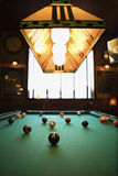 Balls on pool table. Green billiards table with pool balls spread out royalty free stock photography