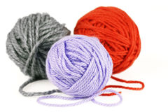 Balls of purple, orange and grey yarn or wool Stock Photos