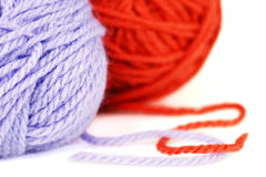 Balls of purple and orange yarn or wool Stock Image