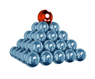 Balls Pyramid. 3d pyramid of shiny blue balls with red ball on top Royalty Free Stock Image