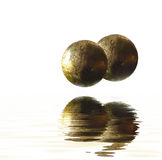 Balls reflecting on water Royalty Free Stock Photos