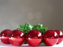Balls & Reflections. Red Christmas ornaments, green ribbon, reflections Royalty Free Stock Images