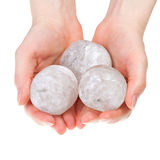 Balls of rock salt in hands Royalty Free Stock Images