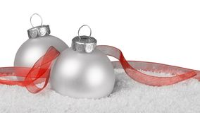 Silver shiny christmas balls in snow isolated on. Balls shiny christmas silver happy holidays holiday party leisure Royalty Free Stock Photography