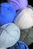 Balls and skeins of yarn. Close up of yarn textures and colors clustered together. Varied colors, some new and rolled balls, others the remnants from past royalty free stock photo