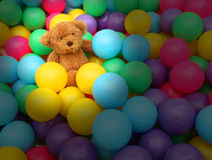 Balls small many color number much and doll bear brown Royalty Free Stock Photography