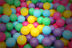 Balls small many color number much and doll bear brown Royalty Free Stock Photo