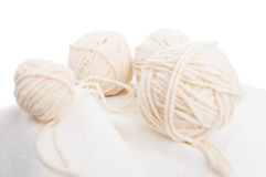 Balls of soft wool on cotton fabric Royalty Free Stock Images